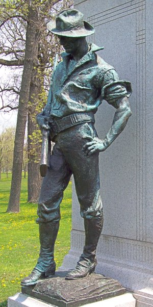 Statue of Spanish-American War soldier with cartridge belt.