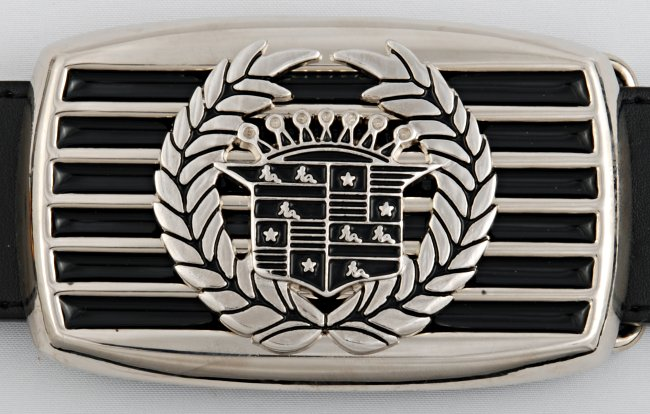 girl in cadillac shield and laurels on car grille chrome with black