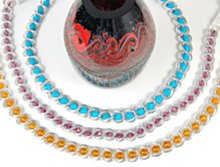 beaded silver double link chain belts about red and black vase