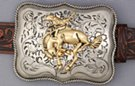 nickel and brass bustin' bronco belt buckle, swirled field and rope edge