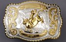 silver and gold tone rodeo bull rider western belt buckle