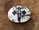 biker cross mirror buckle on stone