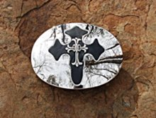 biker cross mirror buckles on stone