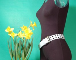 eyelets and stars leather grommet belt with spring daffodils