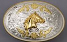 silver and gold tone horse head oval western belt buckle