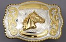 silver and gold tone horse head western belt buckle
