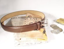 dress belt with abacus, coins and financial newspapers
