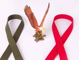 olive and red web belts with eagle statuette