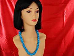model with turquoise necklace