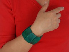 woman in red with green bracelet